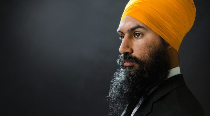 Leadership contender Jagmeet Singh dances on stage with supporters after speaking at the NDP's Leadership Showcase in Hamilton, Ont. on September 17 , 2017. Singh's campaign says it has enrolled 47,000 of the 124,000 NDP members eligible to vote for the next leader.